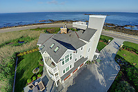 The 84-foot tall Tower House in Rye, NH. An unusual angle showing the entire back of the house and its setting on a point overlooking the Atlantic. Taken for Coastal Home Magazine.