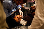 "November 22, 2011 – Cairo, Egypt - A protestors with a rubber bullet wound in his eye receives medical care at field hospitals set up around Tahrir square to deal with the increasing number of injuries. The police have been targeting eyes for days and many have become blind. Most suffer from the extreme side effects of the type of tear gas used by the police, while others have bullet wounds from real and rubber bullets. Protest organizers called today for a ""million man march,"" thousands turned out. Egypt's military leader promised a faster transition to civilian rule, saying Tuesday that presidential elections will be held by the end of June 2012. But the major concession was immediately rejected by tens of thousands of protesters in Cairo's Tahrir Square who responded with chants of ""leave, leave"" now. Photo credit: Trevor Snapp"