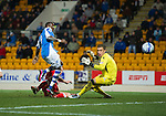 St Johnstone v Ross County...17.11.12      SPL.Gregory Tade's effort is deflected wide by Ross Tokely.Picture by Graeme Hart..Copyright Perthshire Picture Agency.Tel: 01738 623350  Mobile: 07990 594431