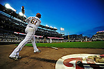 21 June 2010: Washington Nationals' starting pitcher Livan Hernandez takes a practice swing on deck during a game against the Kansas City Royals at Nationals Park in Washington, DC. The Nationals edged out the Royals 2-1 in the first game of their 3-game interleague series, snapping a 6-game losing streak. Mandatory Credit: Ed Wolfstein Photo