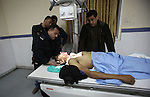 Palestinians gather around the body of Ahmad Najjar, 20, on a hospital bed after he was shot dead by Israeli soldiers in the West Bank village of Burin near Nablus January 31, 2015. Israeli soldiers shot dead Najjar on Saturday in the occupied West Bank, the military and a Palestinian security official said. Photo by Nedal Eshtayah