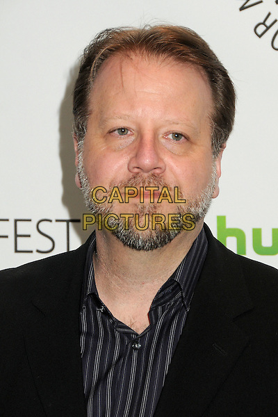 "Andrew Marlowe.PaleyFest 2012 Presents ""Castle"" held at The Saban Theatre, Beverly Hills, California, USA, 9th March 2012..portrait headshot  beard facial hair black jacket grey gray shirt .CAP/ADM/BP.©Byron Purvis/AdMedia/Capital Pictures."