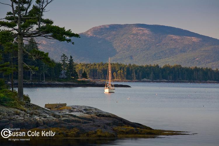 A sailboat at sunrise near Cadillac Mountain in Acadia National Park, ME, USA