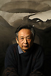 Gao Xingjan in his studio in Paris with his paintings.