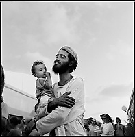 Shirat Ayam Settlement, Gaza strip Israel, Aug. 2005..The last evening prayer in the settlement before its evacuation. Tomer and his son.
