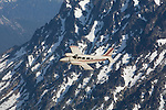 Seneca aircraft flying over the Mount Stuart Range of the Washington Cascades.