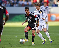CARSON, CA - March 18,2012: DC United midfielder Marcelo Saragosa (11) and LA Galaxy midfielder David Beckham (23) during the LA Galaxy vs DC United match at the Home Depot Center in Carson, California. Final score LA Galaxy 3, DC United 1.