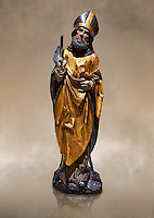 Gothic wooden statue of Sant Nicolau (Nicholas) from Gremany, circa 1500, tempera and gold leaf on wood, from the church of San Miguel de Medina del Campo, Valladolid..  National Museum of Catalan Art, Barcelona, Spain, inv no: MNAC  65507. Against a art background.