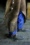 American Cowboy Boots and Chaps - A cowboy is an animal herder who tends cattle on ranches in America traditionally on horseback and often performs other ranch related tasks. The American cowboy of the late 19th century arose from the vaquero traditions of northern Mexico and became a figure of special significance and legend while a wrangler, specifically tends the horses used to work cattle. In addition to ranch work, some cowboys participate in rodeos.
