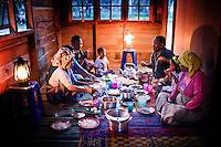 Burhananddin Yusut and his family start the Feast of Ramadan. It is their first meal in their newly built home, completed that afternoon. Their previous home was destroyed, and belongings lost in the Asian Tsunami a year earlier. <br /> <br /> Banda Aceh, Indonesia