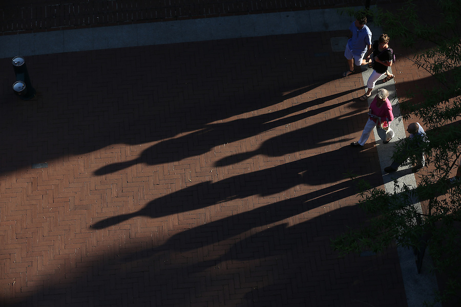 Patrons of the Downtown Mall walk on the brick covered walkways in Charlottesville, Va. Photo/Andrew Shurtleff