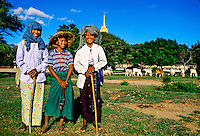 Cattle herding women, Ananda Temple in background, Bagan (Pagan), Burma (Myanmar)