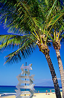 SIgn with arrows pointing to various destinations on Kaanapali beach, Maui