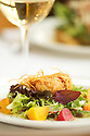 Crab Cake salad by Chef/Owner Cory Schreiber, with Pinot Gris wine from Eyrie Vineyards; Wildwood Restaurant, Portland, Oregon.