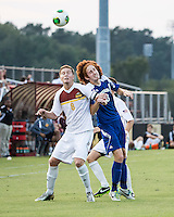 Winthrop University Eagles vs the Brevard College Tornados at Eagle's Field in Rock Hill, SC.  The Eagles beat the Tornados 6-0.  Magnus Thorsson (8) and Augusto Isern (18) vie for the header.
