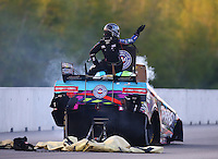 Jun 3, 2016; Epping , NH, USA; Smoke comes from the car of NHRA funny car driver Courtney Force as she climbs from the emergency roof escape hatch after an engine fire during qualifying for the New England Nationals at New England Dragway. Mandatory Credit: Mark J. Rebilas-USA TODAY Sports