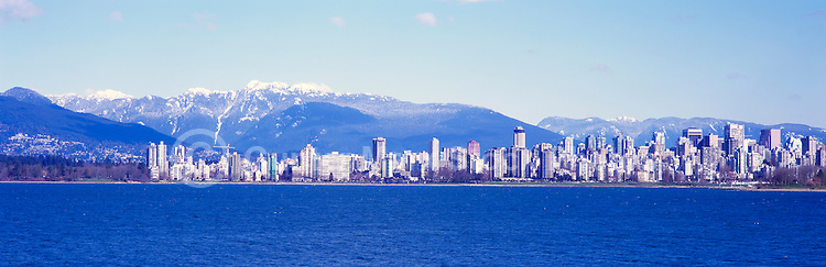 "City of Vancouver ""West End"" and Downtown Skyline at English Bay, BC, British Columbia, Canada, in Spring.  Stanley Park is to the left midground, and the North Shore Mountains (Coast Mountains) rise above the City. - Panoramic View"