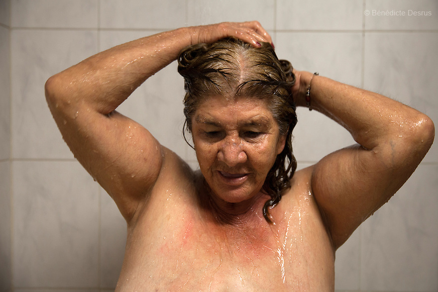 Gloria, a resident at Casa Xochiquetzal, takes a shower at the shelter in Mexico City, Mexico on September 30, 2013. Casa Xochiquetzal is a shelter for elderly sex workers in Mexico City. It gives the women refuge, food, health services, a space to learn about their human rights and courses to help them rediscover their self-confidence and deal with traumatic aspects of their lives. Casa Xochiquetzal provides a space to age with dignity for a group of vulnerable women who are often invisible to society at large. It is the only such shelter existing in Latin America. Photo by Bénédicte Desrus