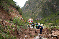 Workers clear a landslide from the tracks. During the rainy season, January to March, the route is heavily affected by landslides. Some can be cleared from the tracks in less than an hour while others force the tren macho to turn around and head back home.
