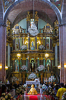 Wedding ceremony in a beautiful and ornamental cathederal in San Miguel de Allende, Mexico.
