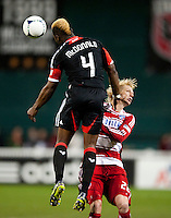 Brandon McDonald (4) of D.C. United heads the ball away from Brek Shea (20) of FC Dallas at RFK Stadium in Washington DC.   Dallas FC fell to D.C. United, 4-1.