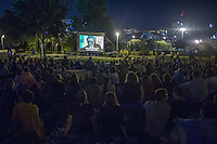 Israeli secular watch a movie near the new Cinema City building in Jerusalem on Friday, August 9, 2013. as they calling for the opening of the new Cinema City in Jerusalem on Sabbath.  Photo by Oren Nahshon