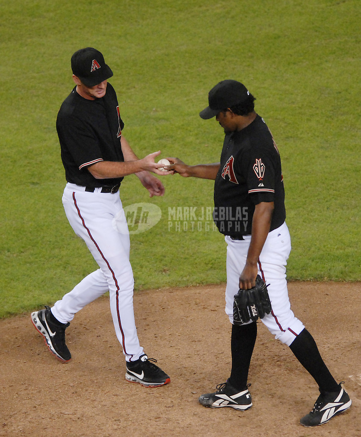 Oct 12, 2007; Phoenix, AZ, USA; Arizona Diamondbacks pitcher (47) Jose Valverde hands the ball to manager Bob Melvin after loading the bases and walking in a run in the 11th inning against the Colorado Rockies during game 2 of the 2007 National League Championship Series at Chase Field. Mandatory Credit: Mark J. Rebilas-US PRESSWIRE