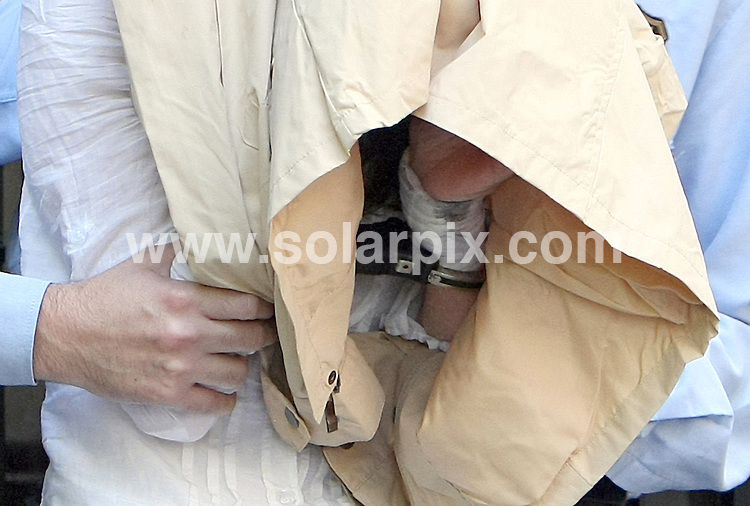**PICTURES FROM SOLARPIX.COM**.**WORLDWIDE SYNDICATION RIGHTS**.Lianne Smith in handcuffs, leaving the apartment in Barcelona that she shared with paedophile husband Martin Smith before she murdered their son and daughter in the Hotel Miramar in Lloret de Mar on Tuesday. She was taken ther by police in attempts to piece together events before the crime...This pic:   Lianne Smith being led out of the apartment in Barcelona in handcuffs covered by a jacket. Here her handcuffs can be seen and she also appears to have her wrists bandaged...JOB REF:    11286    AB1       DATE:   20.05.10.**MUST CREDIT SOLARPIX.COM OR DOUBLE FEE WILL BE CHARGED**.**MUST NOTIFY SOLARPIX OF ONLINE USAGE**.**CALL US ON: +34 952 811 768 or LOW RATE FROM UK 0844 617 7637**