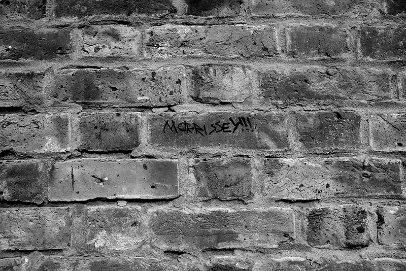 Morrissey sign on a brick wall in Wapping, London, February 2007