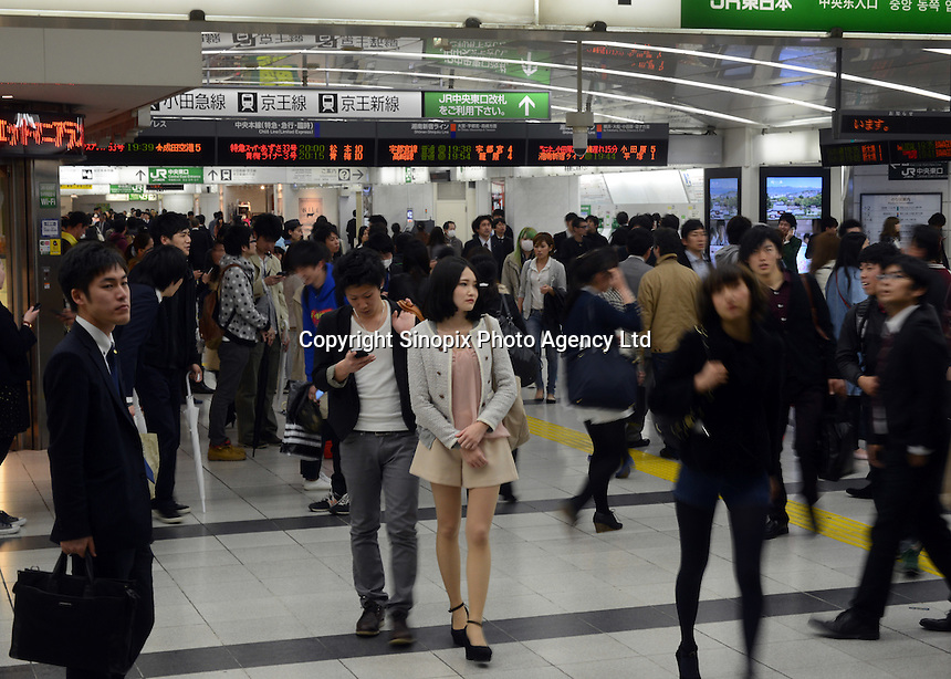 Passengers rush through the East Exit during evening rush hour, Shinjuku, Tokyo. With up to 4 million passengers passing through it every day, Shinjuku station, Tokyo, Japan, is the busiest train station in the world. The station was used by an average of 3.64 million people per day.  That&rsquo;s 1.3 billion a year.  Or a fifth of humanity. Shinjuku has 36 platforms, and connects 12 different subway and railway lines.  Morning rush hour is pandemonium with all trains 200% full. <br /> <br /> Photo by Richard jones / sinopix`