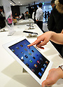 March 16, 2012, Tokyo, Japan - Japanese Apple manias have their hands on the New iPad at the release of the Apples third-generation tablet computer at the flagship store of Sioftbank, Apples Japanese retailer in Tokyos Ginza district on Friday, March 16, 2012. (Photo by Natsuki Sakai/AFLO) AYF -mis-..