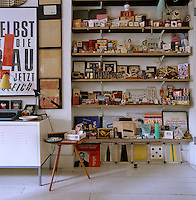 Shelves in this studio contain a collection of packaging, erasers and curios picked up on travels and serve as an inspirational reference
