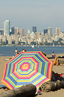 Colourful beach umbrella on Jericho Beach, Vancouver, British Columbia, Canada