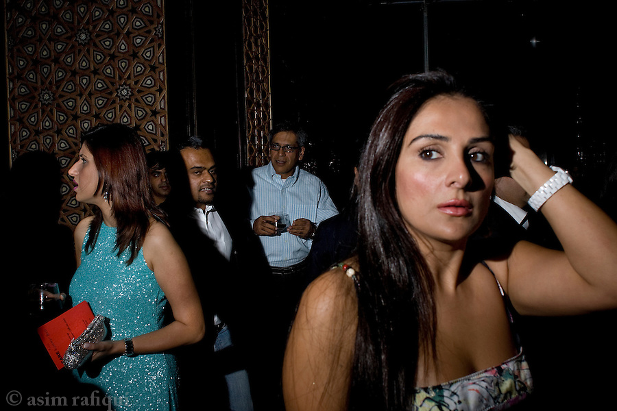 At a charity event in Dubai members of Pakistan's elite come out to play and display.  The lives and social life of the Pakistani elite are increasingly divided between cities like London, Dubai, Bombay and Karachi with social, cultural, professional and personal events taking place in any one of these cities depending on seasons and status.