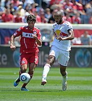 New York forward Thierry Henry (14) passes the ball in front of Chicago midfielder Baggio Husidic (9).  The Chicago Fire tied the New York Red Bulls 1-1 at Toyota Park in Bridgeview, IL on June 26, 2011.