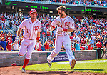 25 July 2013: Washington Nationals outfielder Bryce Harper returns to the dugout after hitting his first career walk-off home run in the bottom of the 9th inning to break a 7-7 tie and defeat the Pittsburgh Pirates 9-7 at Nationals Park in Washington, DC. The Nationals salvaged the last game of their series to end their 6-game losing streak. Mandatory Credit: Ed Wolfstein Photo *** RAW (NEF) Image File Available ***
