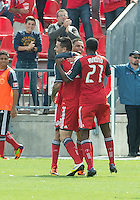 15 September 2012: Toronto FC forward Eric Hassli #29 celebrates his goal with Toronto FC midfielder Luis Silva #11 and Toronto FC defender Aaron Maund #21 during an MLS game between the Philadelphia Union and Toronto FC at BMO Field in Toronto, Ontario..The game ended in a 1-1 draw..