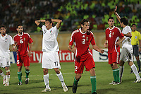Hungary's Janos Szabo (2) celebrates a goal as Italy's Mattia Mustacchio (17) reacts during the FIFA Under 20 World Cup Quarter-final match at the Mubarak Stadium  in Suez, Egypt, on October 09, 2009. Hungary won 2-3 in overtime.