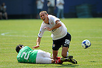 Davy Arnaud (22) of the United States (USA) is tackled by Jonny Magallon (2) of Mexico (MEX). Mexico (MEX) defeated the United States (USA) 5-0 during the finals of the CONCACAF Gold Cup at Giants Stadium in East Rutherford, NJ, on July 26, 2009.