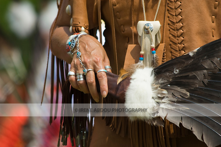 A feather fan and traditional Native American jewelry are carried and worn by a dancer at the 8th Annual Red Wing PowWow in Virginia Beach, Virginia.