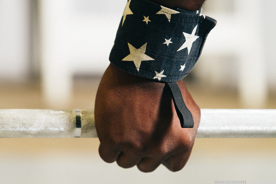 A detail shot of CJ Cummings' American Flag wrist wraps during a training session before a snatch.