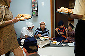 Attendees gather for the community meal at the Sikh Gurudwara of North Carolina in Durham to honor the victims of the Oak Creek shooting on Wednesday August 8th 2012.