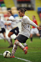 US midfielder Carli Lloyd takes a shot vs Norway on a muddy day in Olhao, Portugal during the 2010 Algarve Cup.