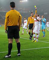 FUSSBALL   EUROPA LEAGUE   SAISON 2012/2013    VfB Stuttgart - FC Kopenhagen   25.10.2012 Tunay Torun (re, VfB Stuttgart) bekommt von Schiedsrichter Artur Manuel Ribeiro Soares Dias (Mitte, Portugal) die Gelbe Karte gezeigt.