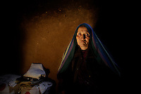"Yawkawlang, Bamyan - Afghanistan. 07/21/2011 ..Shahrbanu lost her husband and two of her sons as the Taliban entered her village on January 8, 2001. Approximately 300 hundred members of the Hazara Shia minority were massacred in the space of 5 days in this province in Central Afghanistan...""I currently live in Mendiag. My name is Shahrbanu. I had five children. The Taliban took two of them with their father. When the Taliban came, it was a bad time. It was winter and there was too much snow..I was at home and they said that the Taliban have come. My husband came and took my two sons early in the morning to some place to hide because he said the Taliban would kill them. A helicopter came from the sky and the Taliban came from the ground and took them. We plead and requested a lot, but they took them..Then someone came and told us to take our martyrs. All the people were lying with their face downwards on the snow. One of my sons was with his father and the other separate. They had beaten them a lot and the brains of one of them had come out. I didn't recognize them first, but I identified them from their cloths. Then we came back. The houses had burned and we had nothing to eat. Our houses and trees and everything were burned and we had nothing.""..."