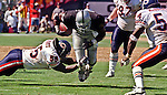 Oakland Raiders vs. Chicago Bears at Oakland Alameda County Coliseum Sunday, September 26, 1999.  Raiders bet Bears  24-17.  Chicago Bears linebacker Sean Harris (55) makes a grab for Oakland Raiders running back Tyrone Wheatley (47).