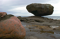 "Haida Gwaii (Queen Charlotte Islands), Northern BC, British Columbia, Canada - ""Balance Rock"" at Low Tide, near Skidegate on Graham Island"