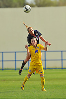 USA defender Rachel Buehler outjumps Swedish forward Kosovare Asllani to win the ball. The USA was victorious over Sweden 2-0 in Ferreiras on March 1, 2010 at the Algarve Cup.