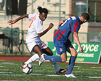 Andrew Marshall #5 of Crystal Palace Baltimore is turned the wrong way by Gregory Richardson #20 of the Carolina Railhawks during an NASL match at Paul Angelo Russo Stadium in Towson, Maryland on September 18 2010. Carolina won 4-2.
