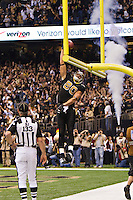NEW ORLEANS, LA - DECEMBER 26:   Jimmy Graham #80 of the New Orleans Saints dunks the football over the goal post after catching a touchdown pass against the Atlanta Falcons at Mercedes-Benz Superdome on December 26, 2011 in New Orleans, Louisiana.  The Saints defeated the Falcons 45-16.  (Photo by Wesley Hitt/Getty Images) *** Local Caption *** Jimmy Graham